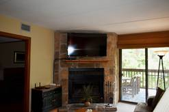 310 High Alpine Resort Living room with wood burning fireplace and Cable TV with Balcony