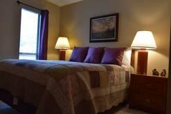 Guest Bedroom with queen bed unit 203