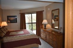 Master bedroom with King bed and full bath Unit #203