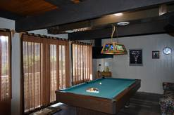 Our Shangrila rec room with pool table and TV