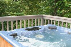 Relax in the hot tub at the Easy Living chalet rental in Gatlinburg.