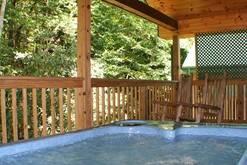 Gatlinburg log cabin rental with a hot tub.
