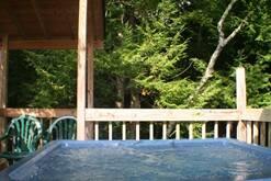 Private Hot Tub on the creek in your Gatlinburg cabin rental. at Gone Fishing in Gatlinburg TN