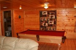 Gatlinburg chalet with a pool table in the game room. at Life's a Bear Retreat in Gatlinburg TN