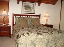 br #4 on main level with queen bed and tv  at When Pigs Fly in Gatlinburg TN