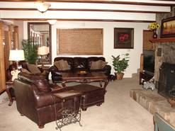 living room with large tv with dvd/vcr and gas fireplace