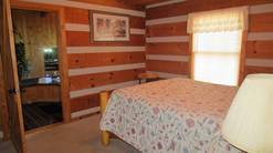 2 gone fishin queen bedroom with adjacent whirlpool room at Gone Fishing in Gatlinburg TN