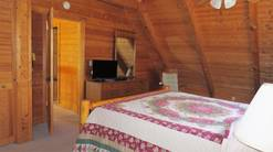 2 gone fishin spacious master bedroom with king bed in gatlinburg tn  at Gone Fishing in Gatlinburg TN