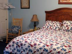 50 birdhouse inn bedroom with queen bed at Birdhouse Inn in Gatlinburg TN