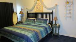 50 birdhouse inn 4 bedroom 4 bath chalet in gatlinburg master bedroom with king bed at Birdhouse Inn in Gatlinburg TN