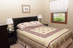 main level bedroom with queen bed