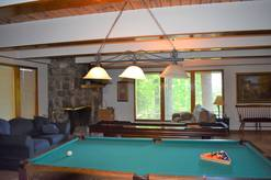 game room with pool table, shuffle board, woodburning fireplace, tv with cable