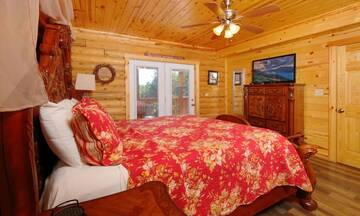 Cabin's master bedroom with private bath, Jacuzzi and Fireplace.
