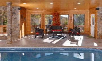 Relax by your cabin rental's indoor swimming pool as other members safely enjoy the water.