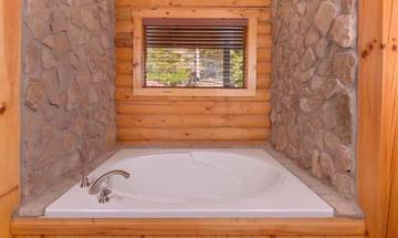 What a way to relax when you soak in your rental cabin's Jacuzzi tub.