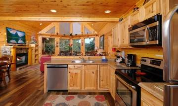 Easy to entertain family and guest with the cabin rental's open kitchen to the living room.