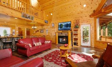 Living room with fireplace in this 4BR cabin rental Pigeon Forge.