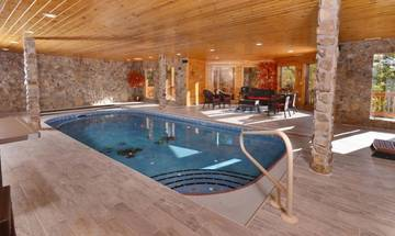 Private indoor pool cabin rental next to Dollywood theme park.