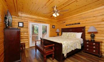 Relaxing spacious bedroom with walk-out to the covered porch.