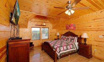 Log cabin's relaxing king sized bed.