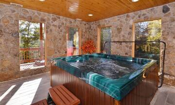 Your 4BR cabin, across from Dollywood, features an all season indoor hot tub.