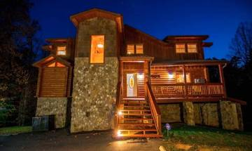 Night view of this beautiful 4BR rental cabin located across from Dollywood Theme Park.