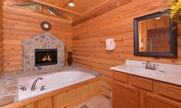 Cabin Rental with master bedroom bath, Jacuzzi & fireplace.