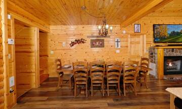 Cabin rental's dining table seats 9.