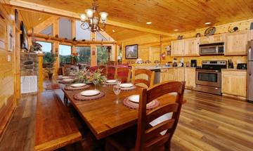 Family meals can be a joy sitting round the cabin's rustic dining table.