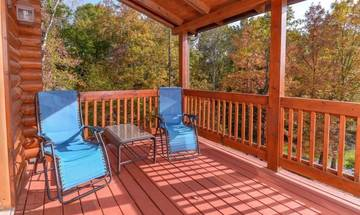Applewood Manor, your rental cabin in the Smokies, features large porches with lots of outdoor furniture.