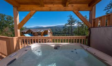 Enjoy the Smoky Mountain views from your rental cabin's large hot tub.