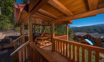 A spectacular Pigeon Forge pet friendly cabin rental with views and an indoor private swimming pool.