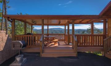 Pigeon Forge rental cabin with large porch, gas grill, charcoal grill, picnic table and endless views of the Smoky Mountains.