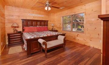 Spacious sleeping quarters with king size bed.