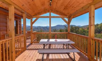 Enjoy a family picnic from your rental cabin's porch.