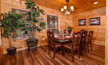 Beautiful cabin with card table.