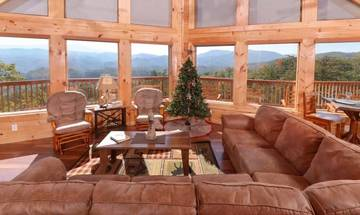 Large spacious rental cabin's living room with mountain views..