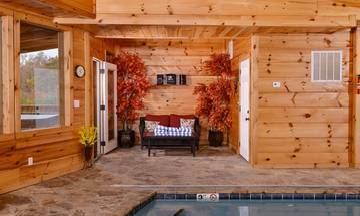 Plenty of seating around your cabin's pool.