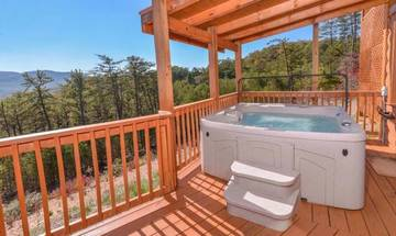 Turn on the hot tub bubbles and soak in the Smoky Mountain views!