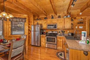 Fully equipped kitchen in 4 Paws cabin, Pigeon Forge Tennessee.