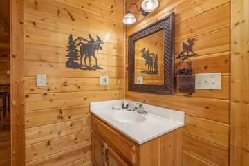 Bath sink at 4 Paws rental cabin.