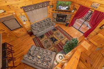 Pigeon Forge rental cabin living room from the loft view.