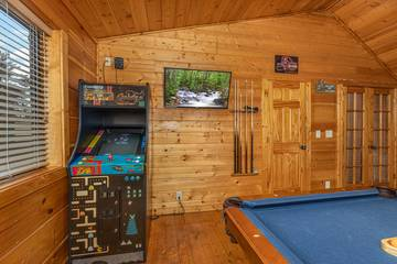 Enjoy several arcade games at your Pigeon Forge rental cabin.