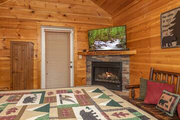Romantic stone gas log fireplace in master bedroom at 4 Paws.