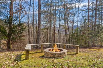 Pigeon Forge rental cabin with fire pit and plenty of seating.