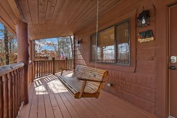 Your relaxing porch swing at 4 Paws cabin rental.