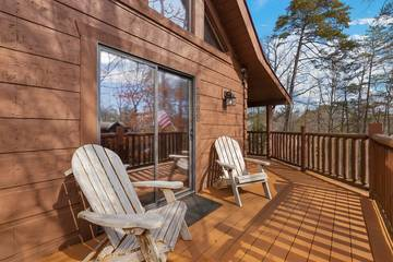 Relax with nature from your cabin's large deck.