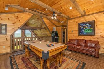 Gather the family round the loft pool table for hours of indoor fun.