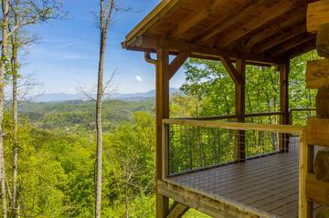 Take in spectacular views of the Smoky Mountains from your cabin's covered porch.
