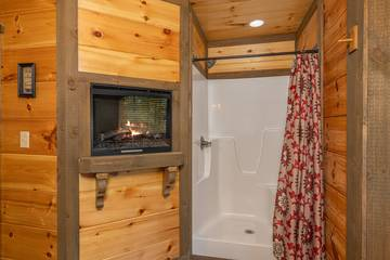 Find added warmth with the master bath's fireplace.